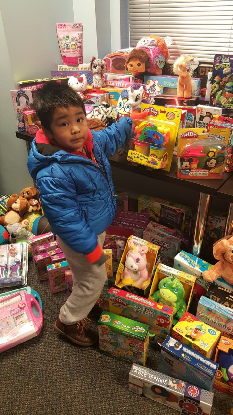 Children choose toys from the donated gifts