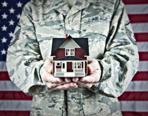 Veteran holding a house